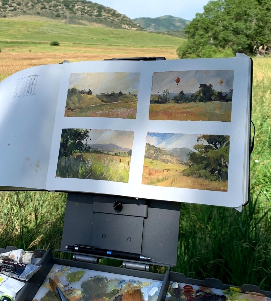 Painting portfolio of landscapes on easel